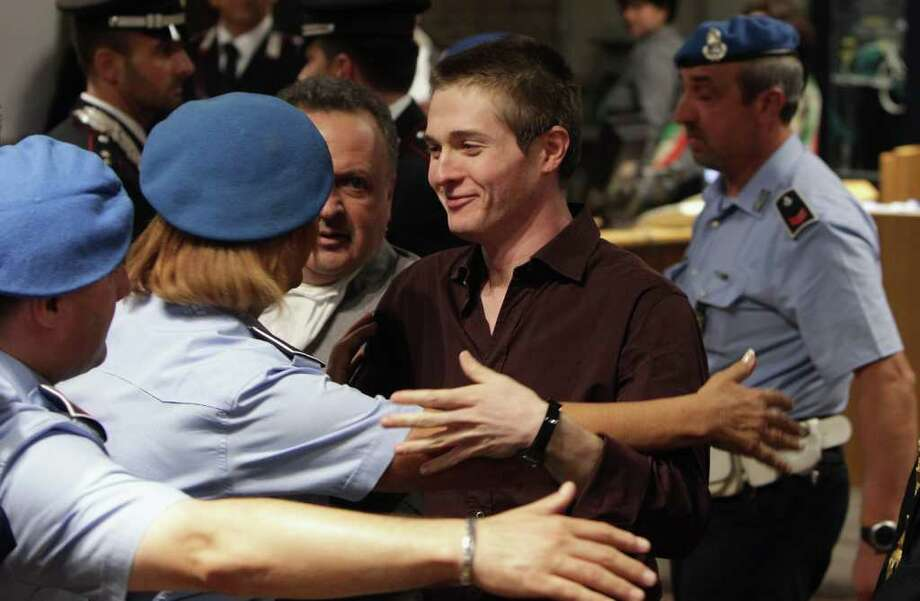 Raffaele Sollecito smiles after hearing the verdict that overturns her conviction and acquits him of murdering his British roomate Meredith Kercher, at the Perugia court, Italy, Monday Oct. 3, 2011. An Italian appeals court has thrown out Amanda Knox's murder conviction and ordered the young American freed after nearly four years in prison for the death of her British roommate. Knox collapsed in tears after the verdict was read out Monday. Her co-defendant, Raffaele Sollecito, also was cleared of killing 21-year-old Meredith Kercher in 2007. (AP Photo/Oli Scarff, Pool) Photo: Oli Scarff, ASSOCIATED PRESS / AP2011