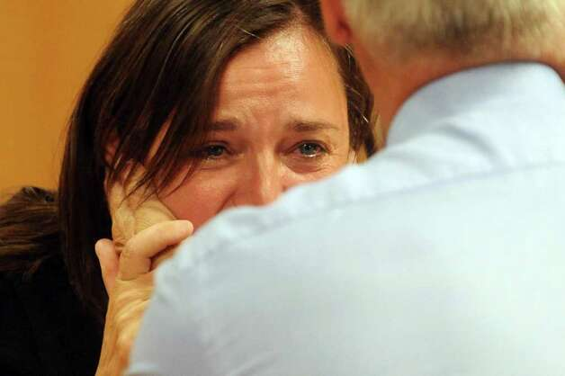 Amanda Knox mother Edda Mellas, left, reacts after hearing the verdict that overturns Amanda Knox conviction and acquits her of murdering her British roomate Meredith Kercher, at the Perugia court, Italy, Monday Oct. 3, 2011. An Italian appeals court has thrown out Amanda Knox's murder conviction and ordered the young American freed after nearly four years in prison for the death of her British roommate. Knox collapsed in tears after the verdict was read out Monday. Her co-defendant, Raffaele Sollecito, also was cleared of killing 21-year-old Meredith Kercher in 2007. Photo: Tiziana Fabi, AP / AFP Pool
