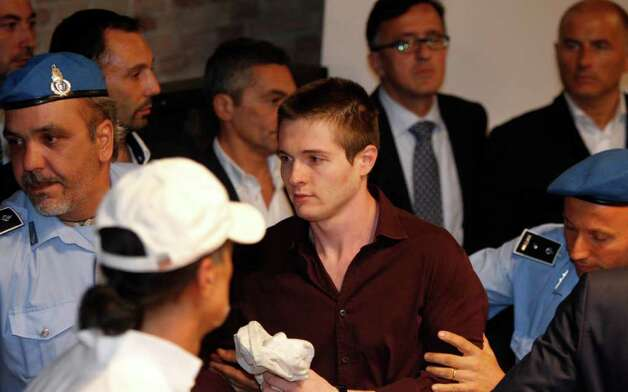 Raffaele Sollecito is taken away after the verdict that overturns his conviction and acquits him and co-defendant Amanda Knox of murdering Amanda's British roommate Meredith Kercher, at the Perugia court, central Italy, Monday, Oct. 3, 2011. Knox, an American student, was convicted of sexually assaulting and murdering Meredith Kercher, her British roommate in Perugia, and sentenced to 26 years in prison. Knox's boyfriend at the time of the 2007 murder, Raffaele Sollecito of Italy, was convicted of the same charges and sentenced to 25 years. Both deny wrongdoing and have appealed the December 2009 verdict. Photo: Pier Paolo Cito, AP / AP