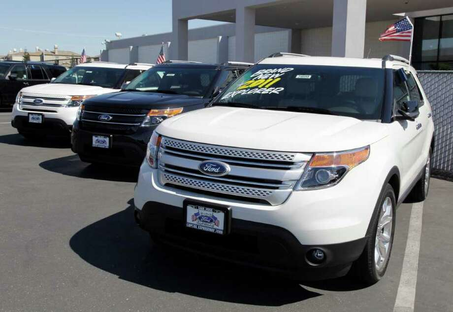 A 2012 Ford Explorer is displayed at a car dealership in San Jose, Calif. Ford Motor Co.'s U.S. sales rose 9 percent in September thanks to strong sales of SUVs and pickups. Photo: Paul Sakuma, AP / AP
