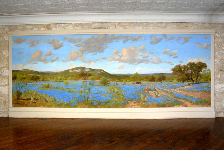 A mural painted in the 1950s by local prominent landscape painter Porfirio Salinas was largely untouched by a four-alarm fire that destroyed a historic building that it hung inside of downtown. This photograph was taken inside the Wolfson Building at East Commerce Street and North Main Avenue before the Saturday morning fire. Photo: Courtesy Photo