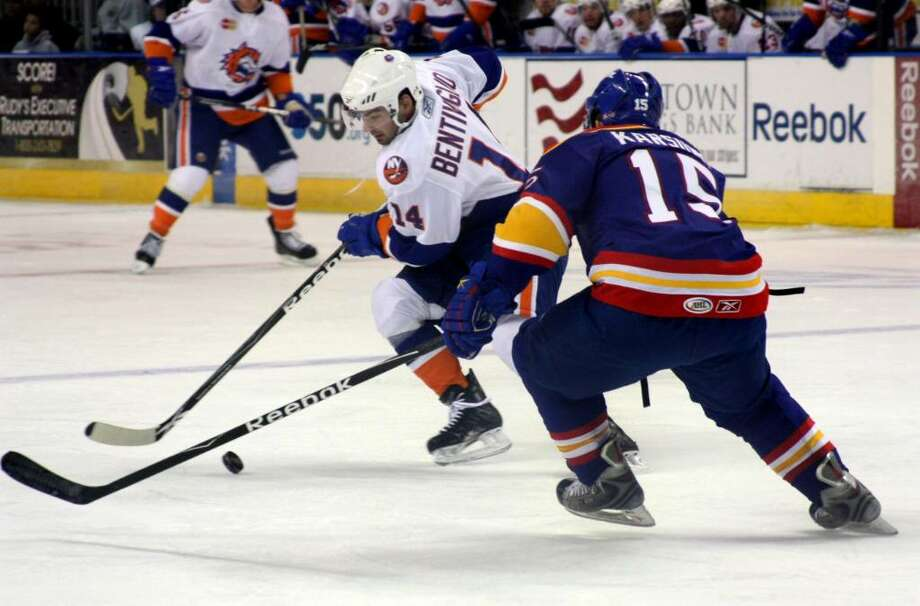 Sound Tigers #14 Sean Bentivoglio works to get past Norfolk's #15 Martins Karsums, during first period game action in Bridgeport, Conn. on Saturday Oct. 17, 2009. Photo: Christian Abraham / Connecticut Post