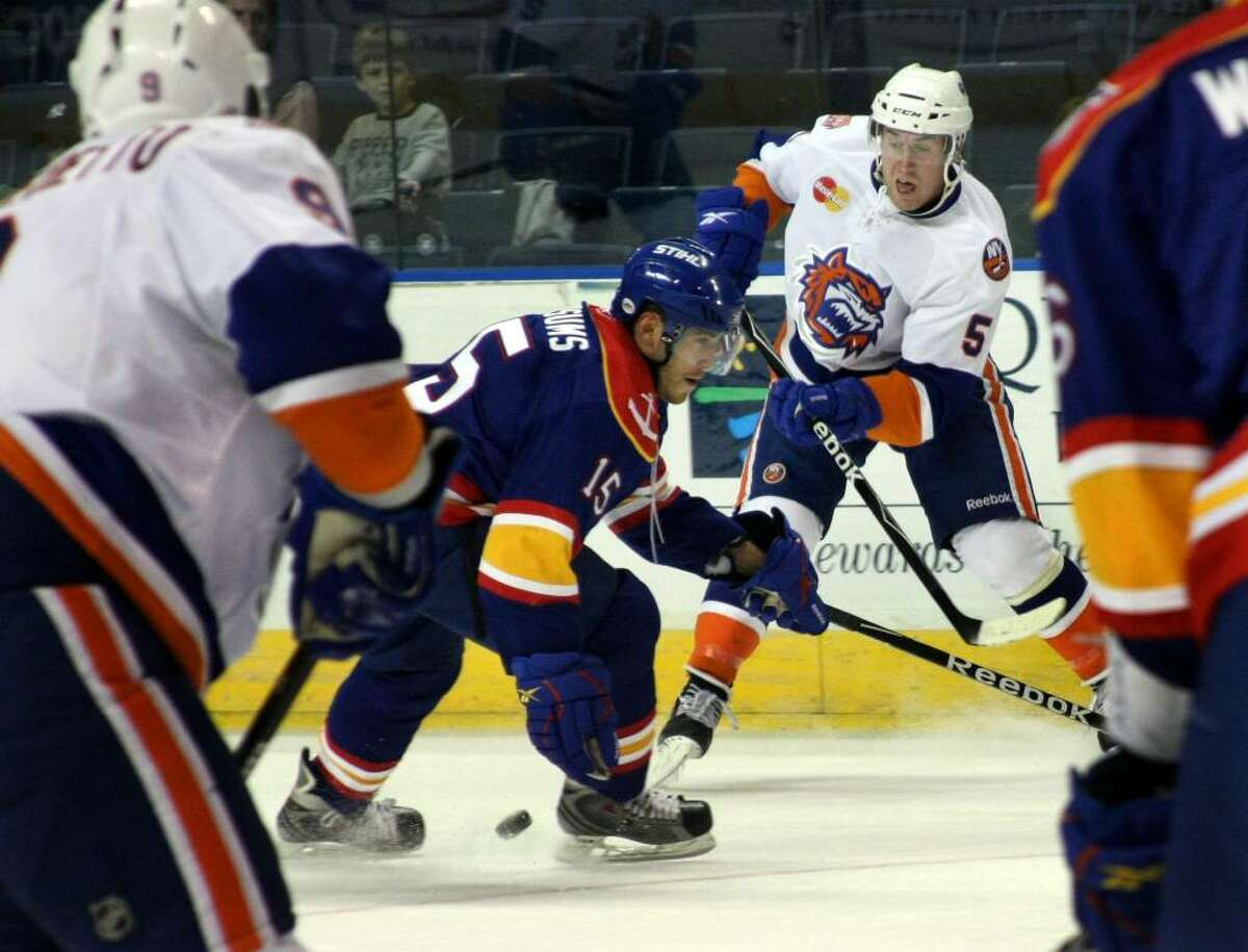Sound Tigers #5 Dustin Kohn tries to pass the puck as Norfolk's #15 Martins Karsums blocks, during first period game action in Bridgeport, Conn. on Saturday Oct. 17, 2009.