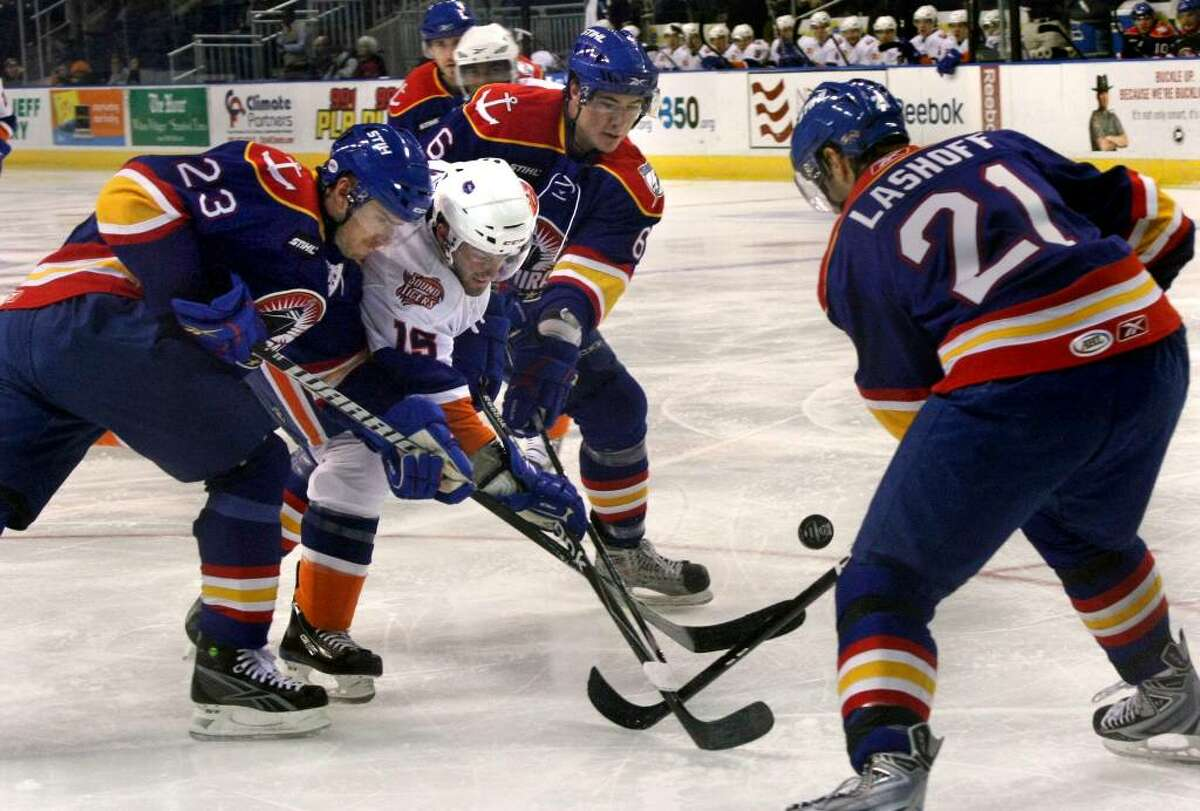 Sound Tigers #15 Greg Moore struggles for the puck as he is surrounded by three Norfolk players, during first period game action in Bridgeport, Conn. on Saturday Oct. 17, 2009. Ringing Moore from left to right is #23 Ryan Craig, #6 Ty Wishart, and #21 Matt Lashoff.