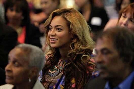 Beyonce Knowles listens while her mother is interviewed. Photo: Melissa Phillip / © 2011 Houston Chronicle