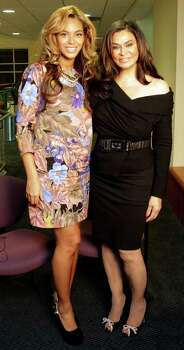 Beyonce Knowles, left, visited University of Houston's MD Anderson Library to support her mother, Tina Knowles, who was being honored Monday by the Friends of Women's Studies Living Archives program. Photo: Melissa Phillip / © 2011 Houston Chronicle