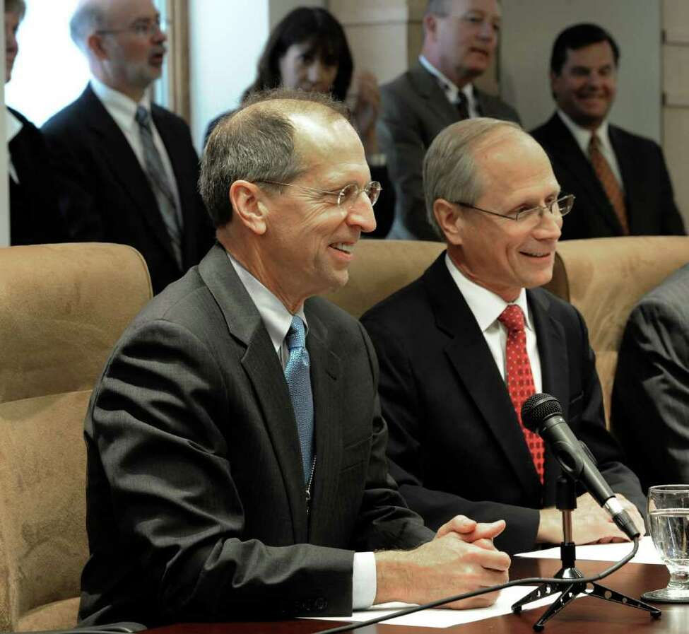Steven Boyle, left is joined by Dr. James Reed in the announcement of the merger between St. Peter's Hospital and three other healthcare facilities in a press briefing in Albany, N.Y. October 3, 2011. (Skip Dickstein / Times Union)