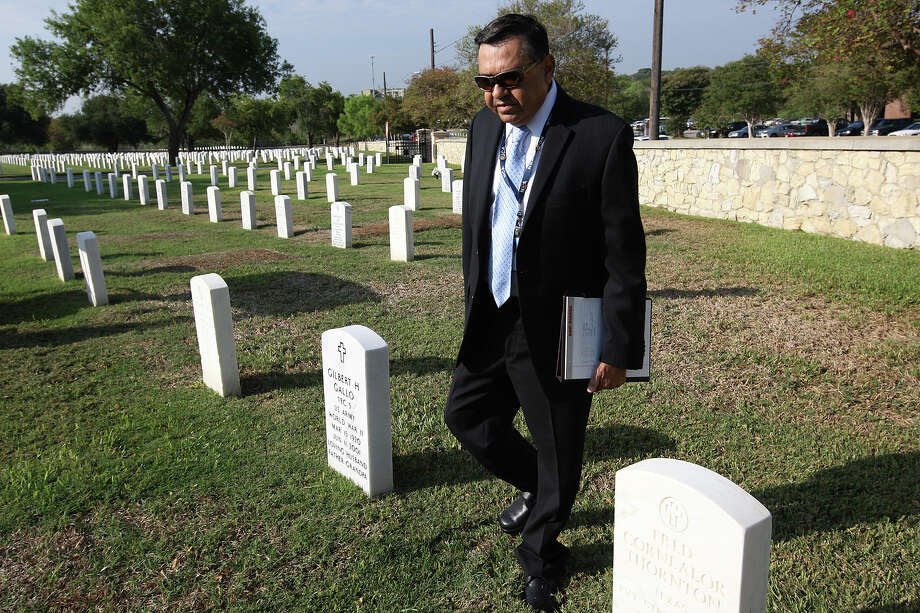 Fort Sam Houston National Cemetery Director Gill Gallo walks by his parents' graves while inspecting plots during a gravesite assessment. Photo: Jerry Lara/glara@express-news.net / SAN ANTONIO EXPRESS-NEWS