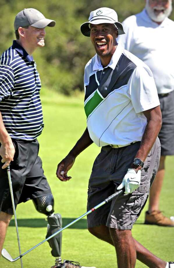 "Bruce Bowen (right) shares a laugh with wounded veteran Matt Miles (left) during the ""Homes 4 Wounded Heroes Celebrity Golf Shootout"" charity event Monday, Oct. 3, 2011 at The Clubs of Cordillera Ranch. Photo: Bob Owen/rowen@express-news.net / rowen@express-news.net"