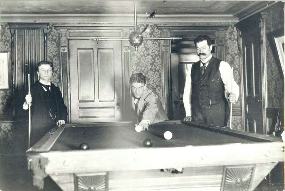 From left, Philip Schlosser, Jacque Schlosser and Conrad Schlosser play a very elegant game of billiards in a Byram house, circa 1900. Photo: Contributed Photo