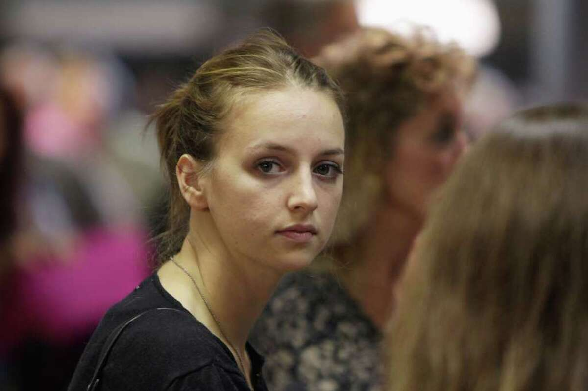 Deanna Knox, the sister of Amanda Knox, joins the Knox family as they prepare to depart from Rome's 'Fiumicino - Leonardo da Vinci' airport for London on their journey back to Seattle on October 4, 2011.