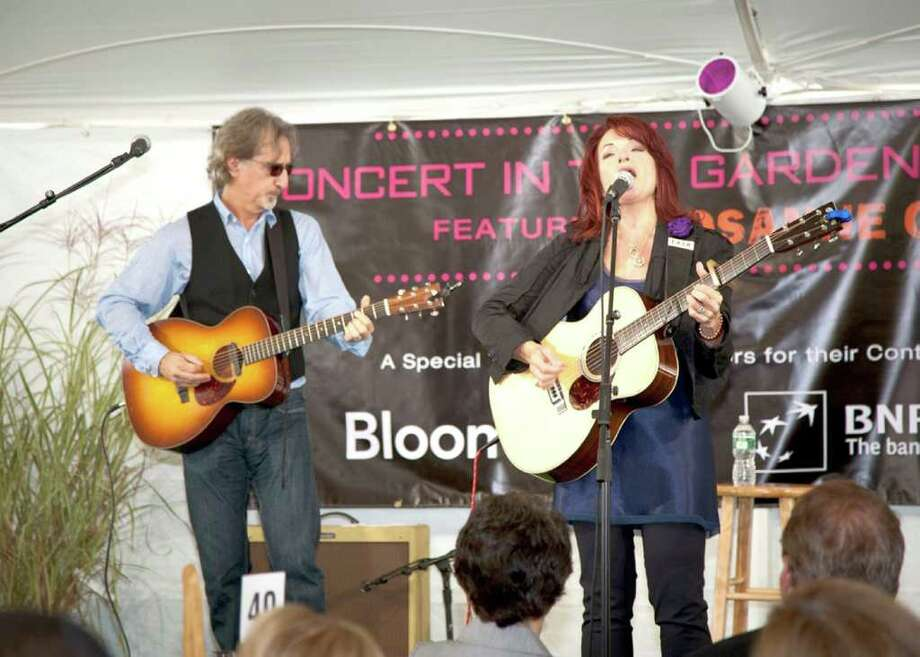 "Rosanne Cash, right, performs at ""Concert in the Garden,"" a benefit concert for Stamford-based Family ReEntry held at the Greenwich estate of Joan Warburg. Accompanying Cash is her husband, John Leventhal. Photo: Contributed Photo"