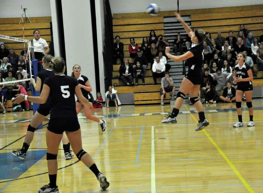 Staples' Kenzie Roof smacks it from the back row against Darien Monday. Roof served four straight points to tie it in the fourth game and staved off four straight match points, which enabled the Lady Wreckers to win the game. Although her heroics enabled Staples to win the game, it lost 3-2 to Darien. Photo: Suzanne Kalb / Contributed Photo