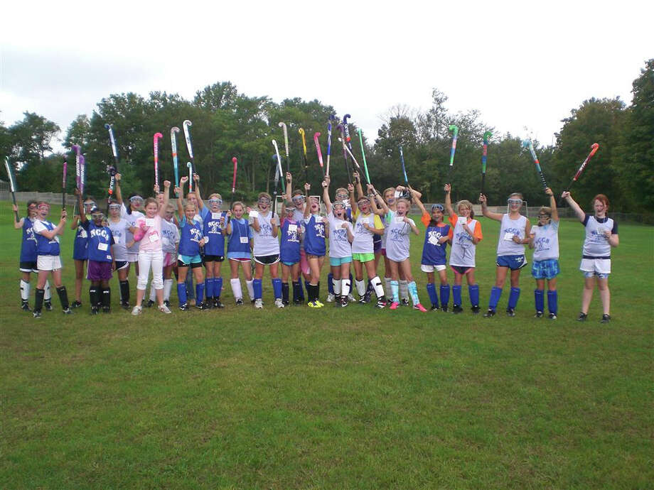 To honor Sept. 22 as the International Day of the Girl, a middle school class at New Canaan Country School took LitWorldís Stand Up for Girls acrostic activity. At noon, they were at field hockey practice, so they took a few minutes to talk about the day and the importance of educating girls worldwide. Photo: Contributed Photo