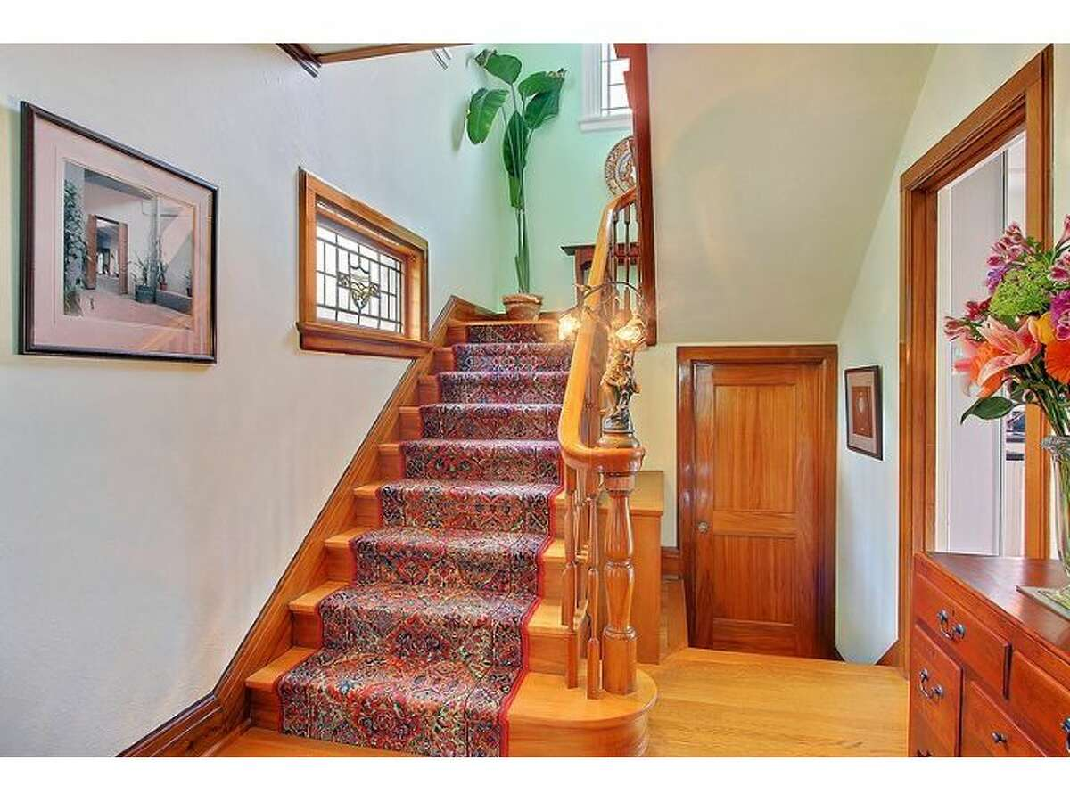 Stairway of 2802 10th Ave. E. The 3,450-square-foot brick Colonial, built in 1924, has three bedrooms and 3.25 bathrooms, tons of exposed wood, leaded glass, radiators, views, a wine cellar, a large deck and a 5,500-square-foot lot. It's listed for $1.295 million.