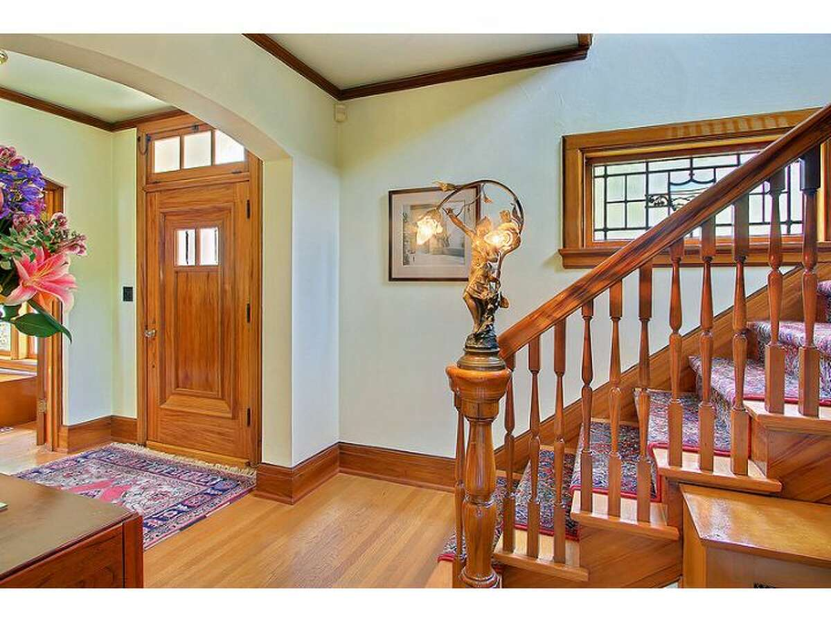 Foyer of 2802 10th Ave. E. The 3,450-square-foot brick Colonial, built in 1924, has three bedrooms and 3.25 bathrooms, tons of exposed wood, leaded glass, radiators, views, a wine cellar, a large deck and a 5,500-square-foot lot. It's listed for $1.295 million.