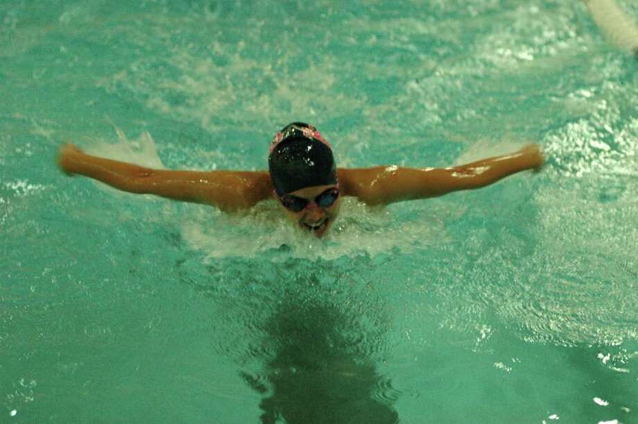 Caroline Valerio wins the 100-meter freestyle Friday in a 101-80 home victory over Ridgefield. Photo: Ron Wimer / Contributed Photo