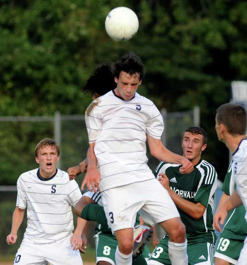 Staples' Ben Root, 3, uses his head against Norwalk Friday. The Wreckers defeated Brien McMahon 1-0 Monday but still missed Root, who was out because he was sick. Photo: Christian Abraham / Staff Photographer