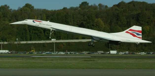 British Airways Concorde arrives at the Museum of Flight on Nov. 5, 2003.  British Airways Concorde lands at Boeing Field (King County Airport  as it completes a 3 hour, 55 min, 12 second flight from New York to Seattle.  Canadian air traffic control opened a supersonic corridor. the plane hit speeds of 1500 mph (twice the speed of sound) and flew as high as 60,000 feet. The plane will be exhibited by the Museum of Flight.   Photo by Grant M. Haller 11/05/2003 Photo: GRANT M. HALLER