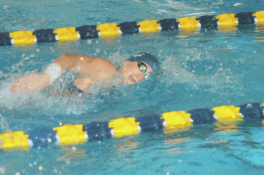 Weston's Katie Johnson swims the 200-yard freestyle against Newtown. Johnson won the 100-yard freestyle in the Lady Trojans' loss to Newtown. Photo: Andy Hutchison / For The Westpor