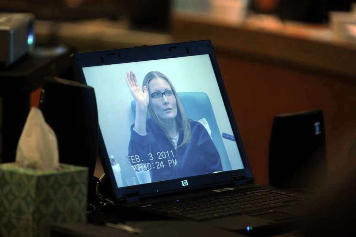 A laptop computer plays the video taped deposition of Nicole Pearce during the trial of Christopher DiMeo in Superior Court in Bridgeport, Conn. Feb. 7th, 2011. Pearce's testimony was recorded at the Uconn Medical Center in Farmington, where she is in treatment for cancer. DiMeo is on trial for the 2005 murders of Fairfield jewelers Kim and Tim Donnelly.