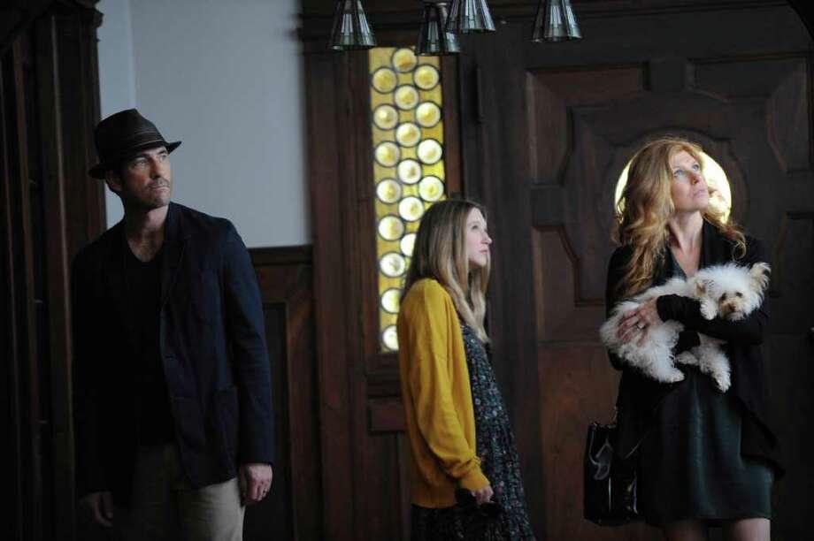 Dylan McDermott as Ben Harmon, Taissa Farmiga as Violet and Connie Britton as Vivien tour their new house in 'American Horror Story'