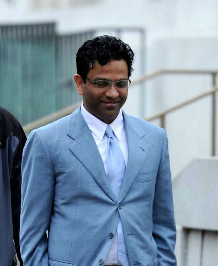 Giridhar Sekhar arrives for his trial in Federal Court in Albany, N.Y., on April 13, 2011, on charges that he allegedly blackmailed Comptroller Tom DiNapoli's top attorney to secure business with the pension fund. (Skip Dickstein / Times Union archive) Photo: SKIP DICKSTEIN / 00012758A