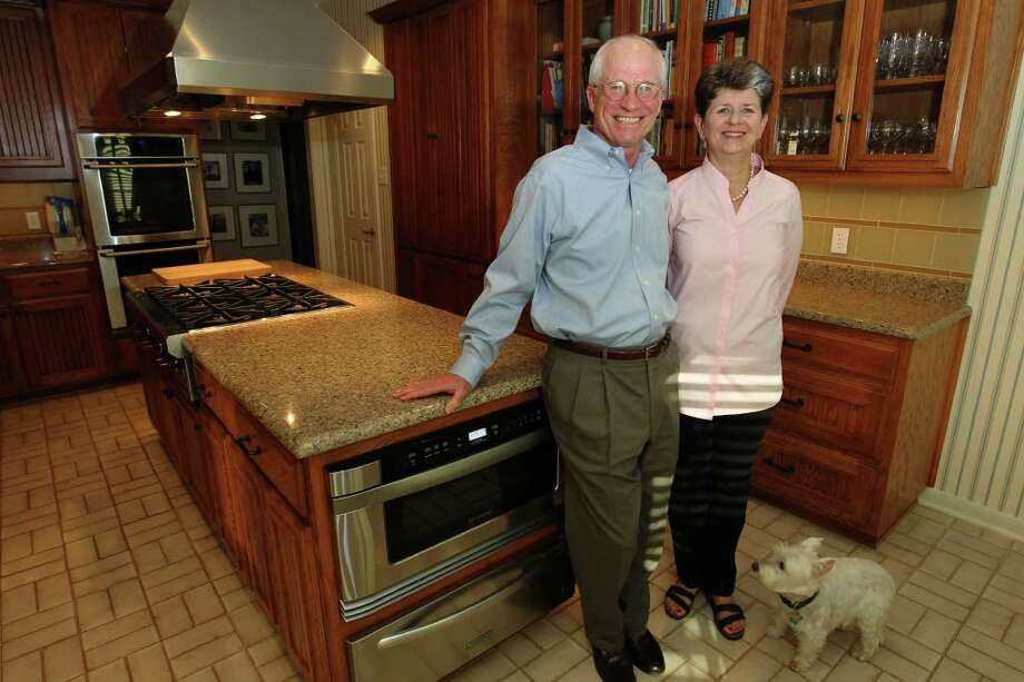 Charles and Ceal Gorham remodeled their kitchen in 2010 to provide room for large family gatherings once a week. They head outside though, to make their huge pots of gumbo. Photo: KIN MAN HUI, SAN ANTONIO EXPRESS-NEWS / SAN ANTONIO EXPRESS-NEWS