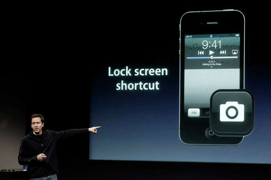 Apple's Scott Forstall talks about the camera on the Apple iPhone 4S during an announcement at Apple headquarters in Cupertino, Calif., Tuesday, Oct. 4, 2011. Paul Sakuma / AP Photo: AP