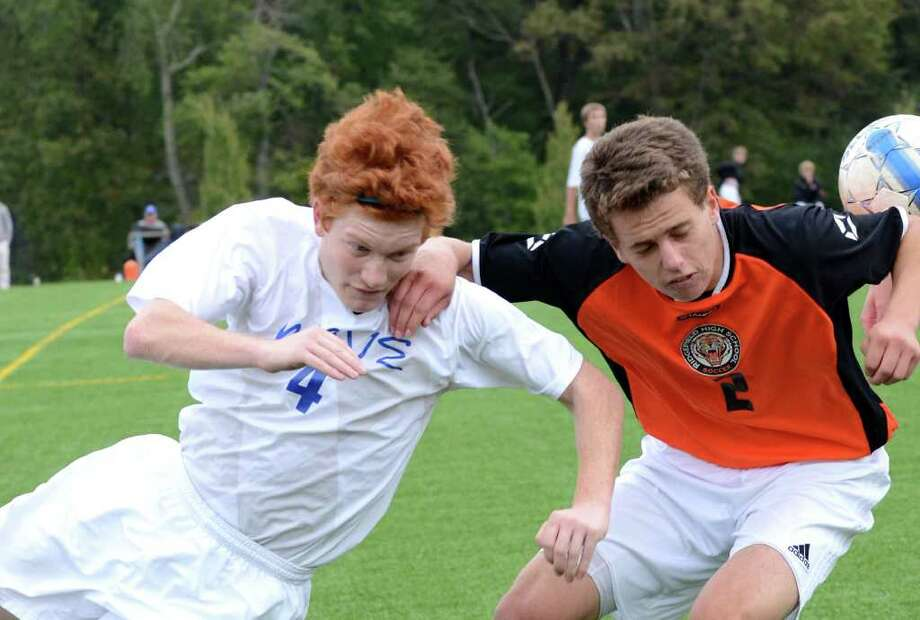 Darien's Geoffrey Hubbard, left, and Ridgefield's Kent Coleman jockey for position during Tuesday's 1-0 win by the Blue Wave. Photo: Amy Mortensen / Connecticut Post Freelance