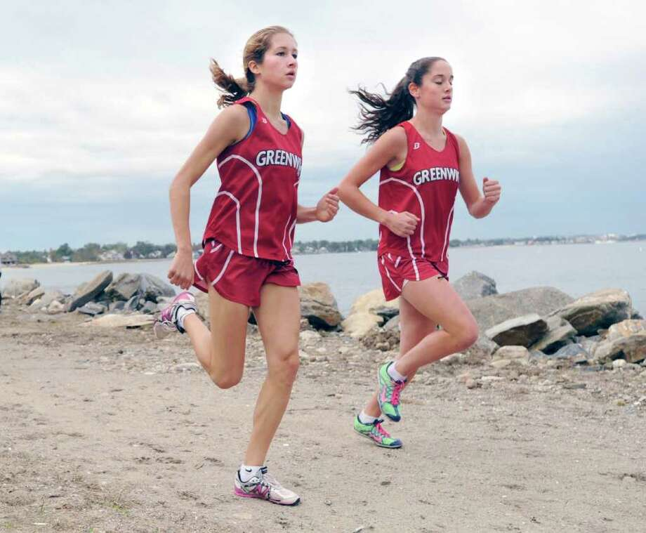 Sarah Fountain, left, and Abby Markowitz both of Greenwich High School compete during cross country meet at Greenwich Point, Tuesday afternoon, Oct. 4, 2011.  Markowitz took first and Fountain came in second. Photo: Bob Luckey / Greenwich Time