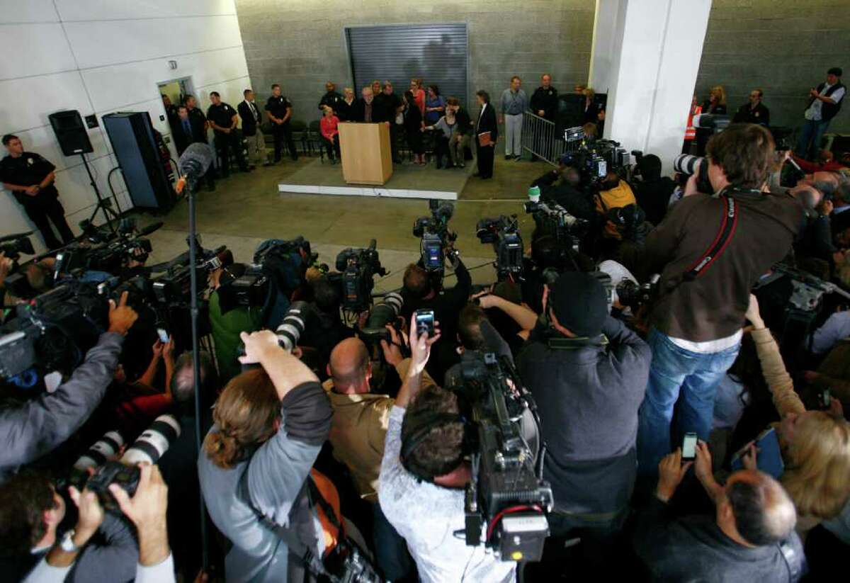 A horde of cameras photograph Amanda Knox as she returns to the United States after her Italian murder conviction was overturned. Knox returned to Seattle on Tuesday, October 4, 2011 to a throng of cameras and well-wishers.