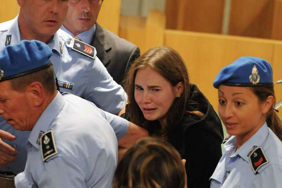 Amanda Knox breaks down in tears after hearing the verdict that overturns her conviction and acquits her of murdering her British roommate Meredith Kercher, at the Perugia court on October 3, 2011 in Perugia, Italy. Photo: Pool, Getty / 2011 Getty Images