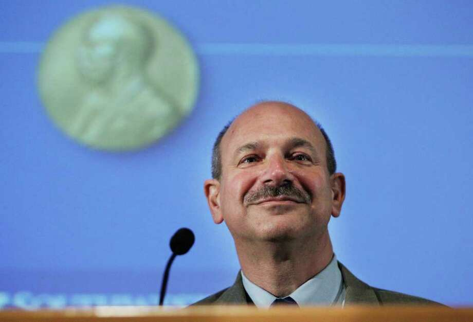 Nobel Prize winner Dr. Bruce A. Beutler addresses his colleagues at University of Texas Southwestern Medical Center on October 4, 2011 in Dallas, Texas. Beutler won the 2011 Nobel Prize in physiology or medicine with two other scientists for their discoveries in how the immune system works.  Photo: Tom Pennington / 2011 Getty Images