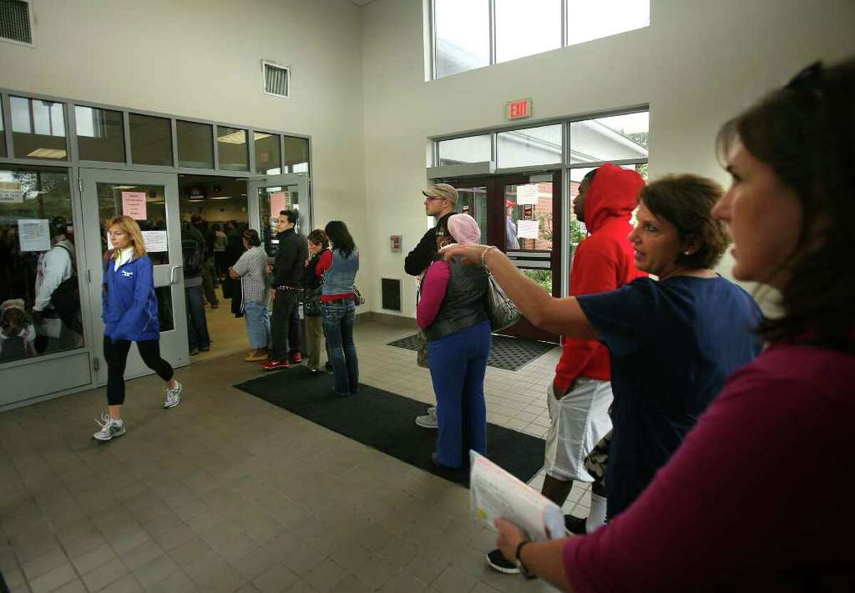 The line snakes through the lobby during a busy morning at the Department of Motor Vehicles in Bridgeport on Tuesday, October 4, 2011.
