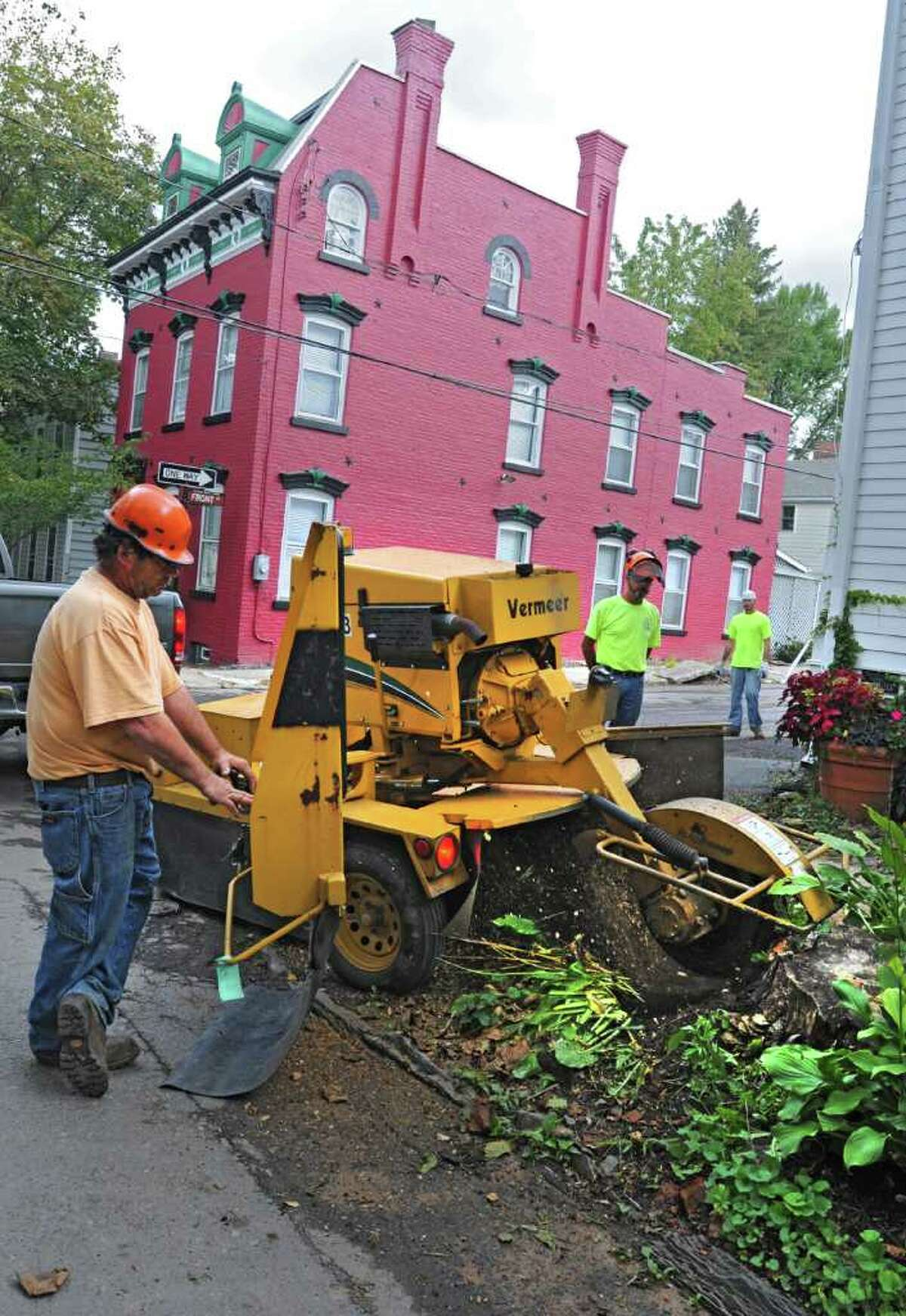 Schenectady parks workers grind down a tree stump on Washington Avenue Tuesday, Oct. 4, 2011. Parks jobs were on the chopping block in last year's budget. But the city's use of savings, or what is called fund balance, for 2012 is helping save jobs and services.