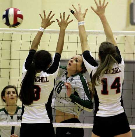 Reagan's Ashton Korona finds a way to get the ball by Churchill defenders as the Rattlers win in three games Tuesday, Oct. 4, 2011 at Littleton Gym. Photo: Tom Reel/treel@express-news.net / treel@express-news.net
