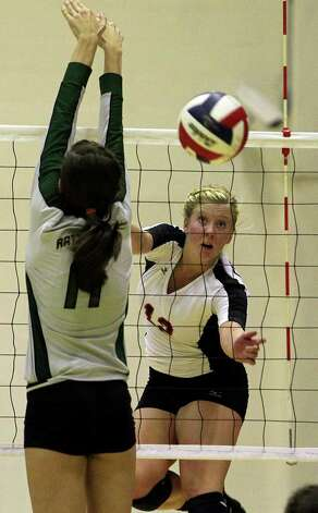 Churchill's Kelsey Raglin gets the ball by Reagan's Ashlie Reasor as the Rattlers win in three games Tuesday, Oct. 4, 2011 at Littleton Gym. Photo: Tom Reel/treel@express-news.net / treel@express-news.net