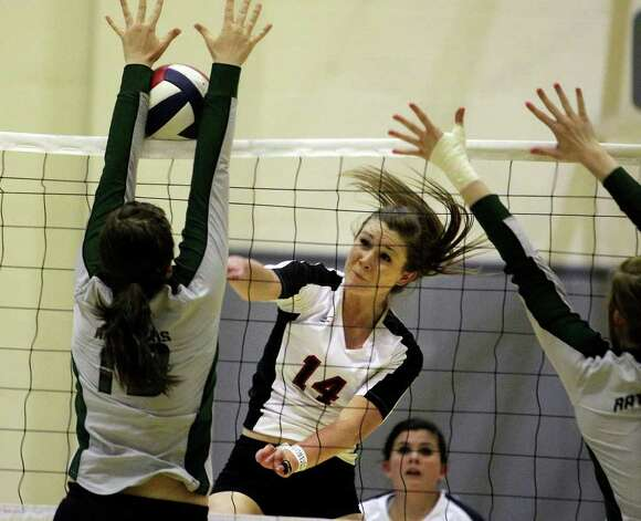 Churchill's Audrey Sanders is blocked by Reagan's Payton Reed as the Rattlers win in three games Tuesday, Oct. 4, 2011 at Littleton Gym. Photo: Tom Reel/treel@express-news.net / treel@express-news.net