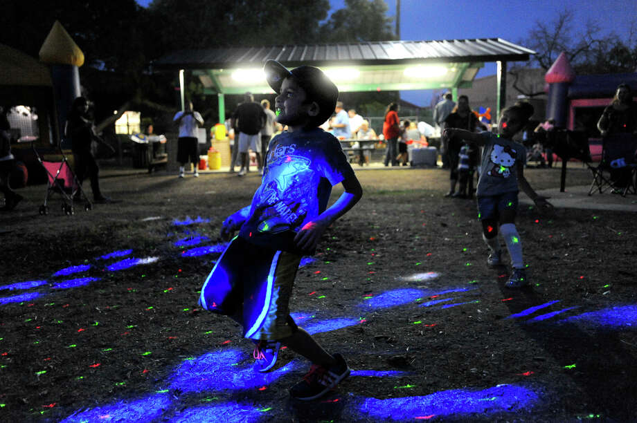 Jeremy Duran, 6, dances during the Harlandale Park Neighborhood Association National Night Out event on Tuesday October 4, 2011 at Harlandale Park. Photo: BILLY CALZADA/gcalzada@express-news.net