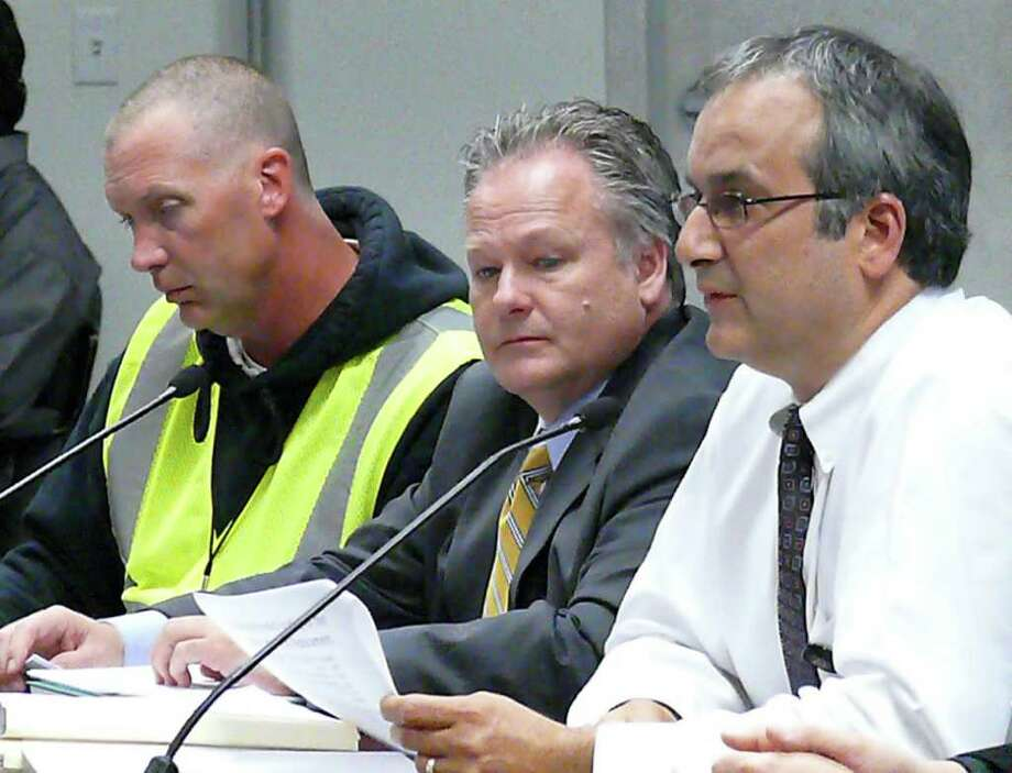 At Tuesday's Board of Finance meeting, from left, Mike Shutler, from Tecta America New England; Board of Education Facilities Manager Tom Cullen and Sal Morabito, manager of construction, security and safety for the school board, answer questions about roof repairs and warranty extension. Photo: Genevieve Reilly / Fairfield Citizen