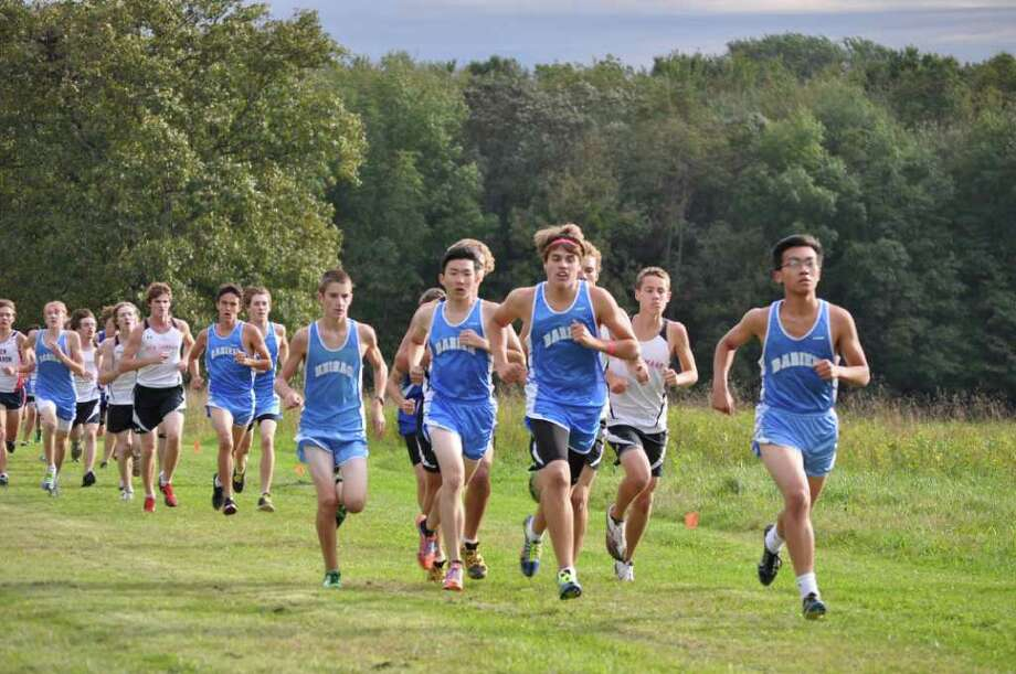 The Darien High School boys cross country team extended its undefeated season in Tuesdayís meet at New Canaanís Waveny Park, boosting its record to 14-0. Photo: Contributed Photo