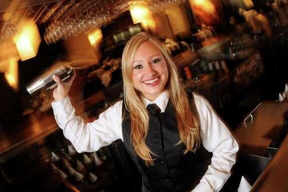 Bartender Ashlea Cutitta at Eddie V's on Kirby Saturday Sept. 24,2011.(Dave Rossman/For the Chronicle)
