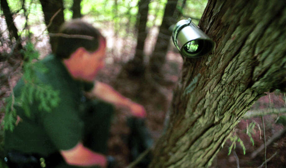 U.S. Border Patrol Agent Ross McCart checks an infrared motion sensor along the Canadian border in Highgate Springs, VT July 26, 2000. Agents say a lack of funding and manpower in the northeast forces them to rely on technology like cameras and motion sensors to monitor border activities.