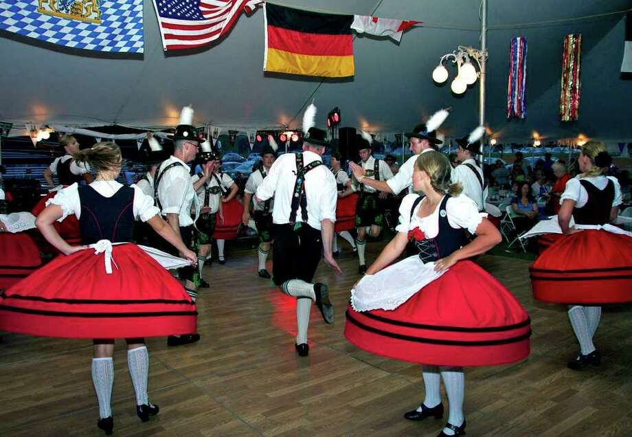 SPECTRUM/In their 52nd season as a group, performers from the Alpenland Tazner Dancers cut quite the image at the Arion Singing Society of New Milford's annual Oktoberfest. Sept. 3-4, 2011 Photo: Trish Haldin