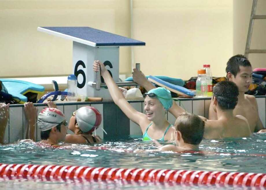 Greenwich resident Katie Evans, 14, enjoys swim practice with the Chinese National Team as part of a group of five swimmers from the Greenwich YMCA Marlins' swim team who visited China, recently. Photo: Contributed Photo