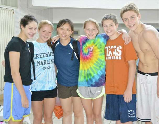 Five members of the Greenwich YMCA Marlins' swim team, along with their coach, spent nearly three weeks in China, recently, where they trained with the Chinese national team and toured the countryside. From left are Sarah Hodes 14, Kim Hill 15, Connie Wu(Head Coach Greenwich Marlins), Katie Evans 14, Oscar Ike 14, and Wyatt Semenuk. Photo: Contributed Photo