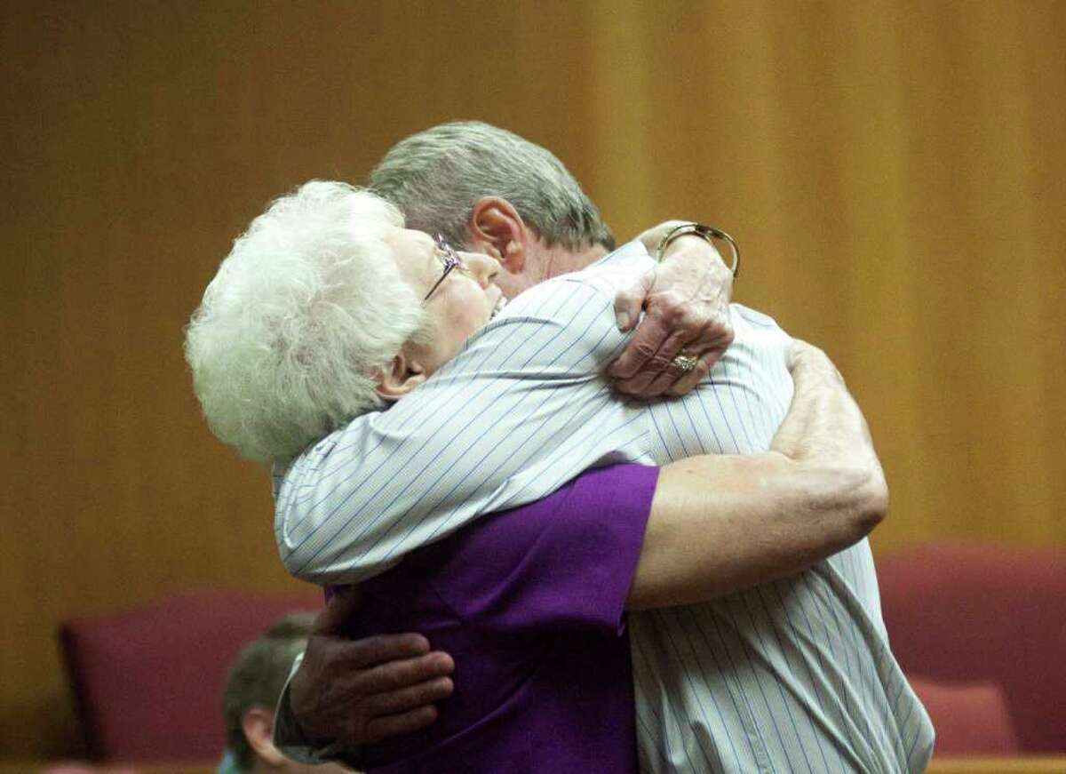 Michael Morton hugs his mother Patricia after his exoneration Tuesday, Oct. 4, 2011, in Georgetown, Texas. Morton, who spent nearly 25 years in prison in his wife's beating death, walked free Tuesday after DNA tests showed another man was responsible. His attorneys say prosecutors and investigators kept evidence from the defense that would have helped acquit him at trial.