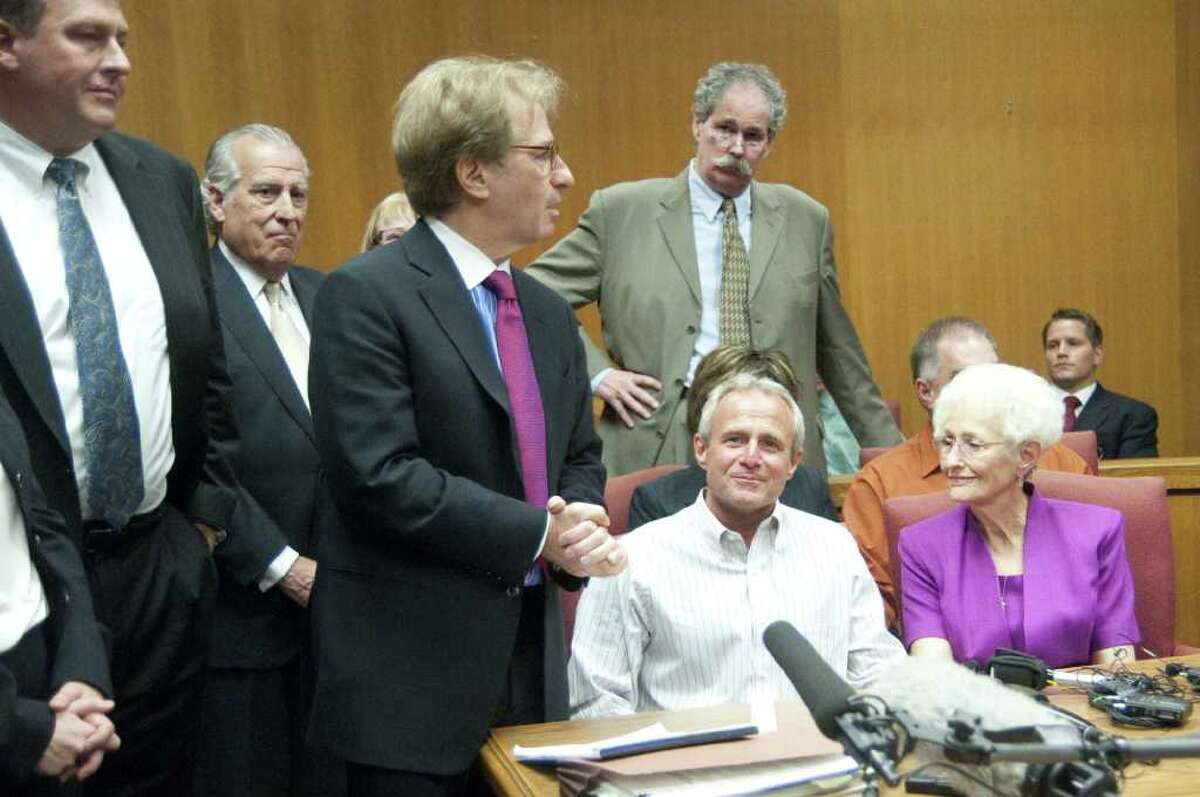 Michael Morton, second right, along with his mother Patricia Morton, holds a news conference after his exoneration on Tuesday, Oct. 4, 2011, in Georgetown, Texas. Morton, who spent nearly 25 years in prison in his wife's beating death, walked free Tuesday after DNA tests showed another man was responsible.