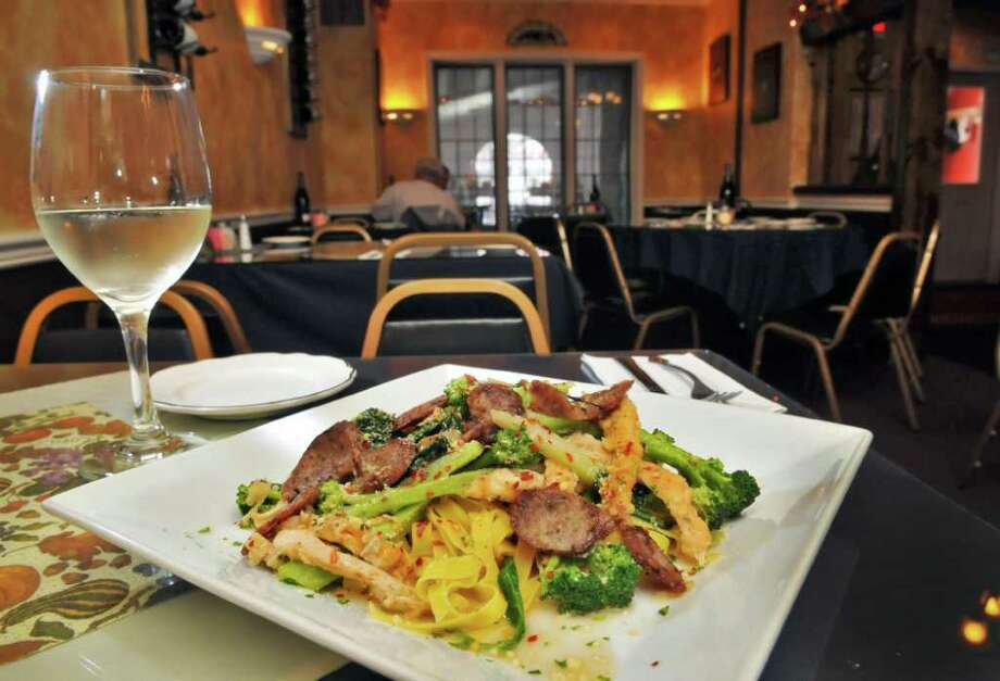 """Fettuccine Liotta at Scotti's Restaurant on Union Street in Schenectady Thursday Sept. 29, 2011.  The dish was created for Ray Liotta, who was coming into the restaurant a lot while shooting """"A Place Beyond the Pines""""    (John Carl D'Annibale / Times Union) Photo: John Carl D'Annibale / 00014799A"""